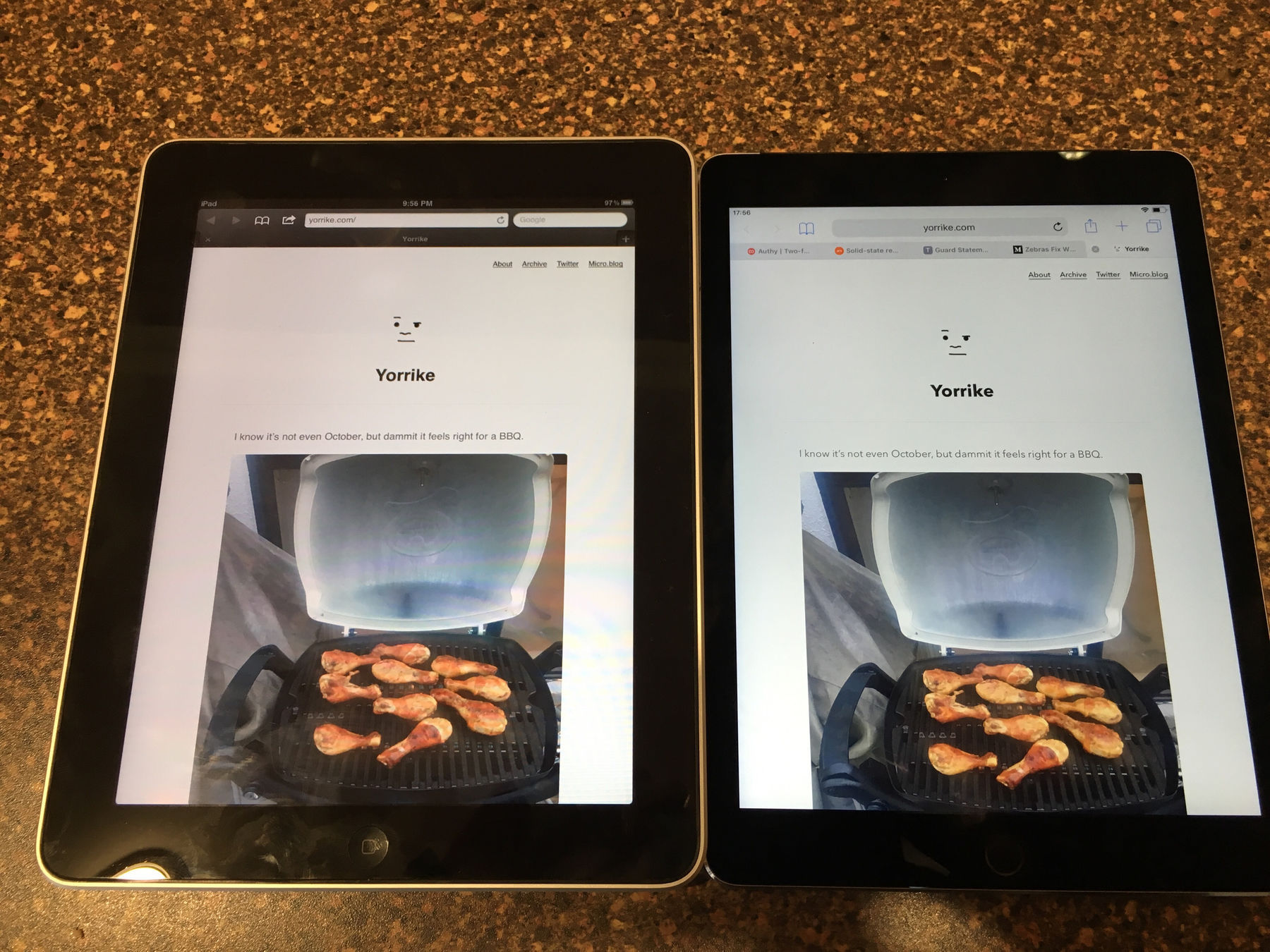 An original iPad and an iPad Air 2, side by side screen up. The original iPad is a little larger than the iPad Air 2, with much arger side bezels.