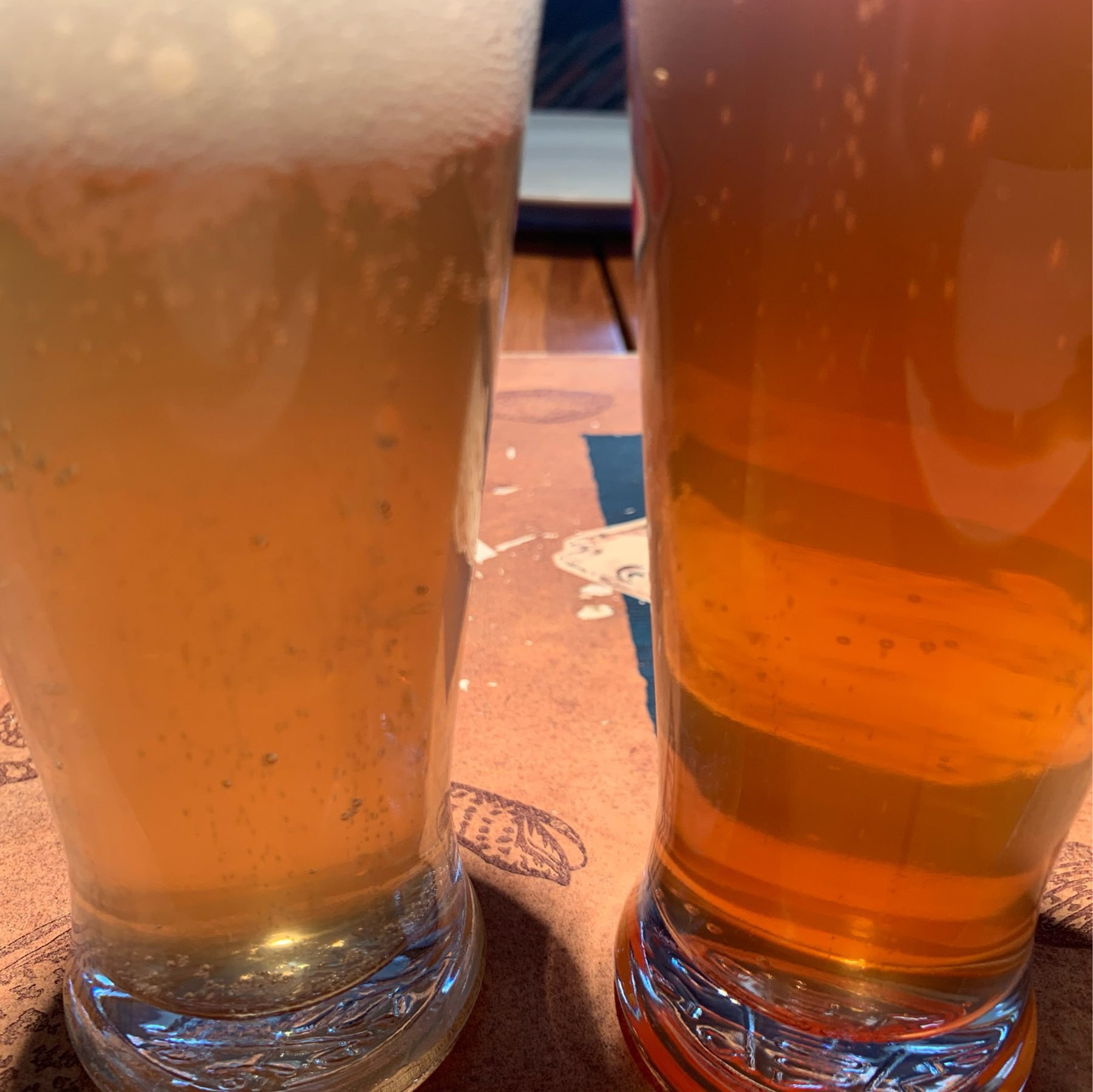 the lime beer on the left is beer uellow, the raspberry infused one on the right is distinctly pink