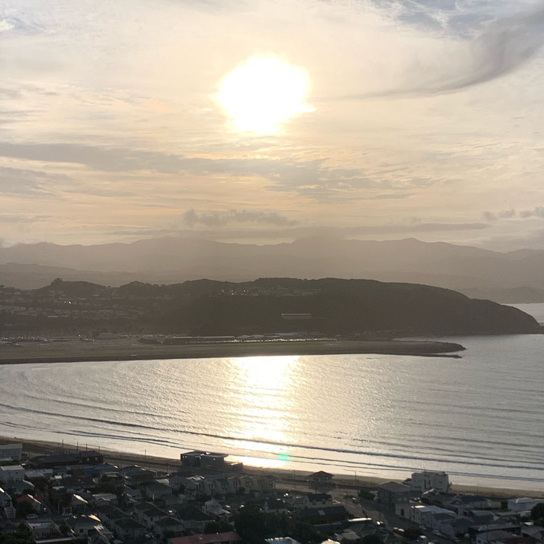 The sun rising over Lyall Bay in Wellington on christmas day 2019