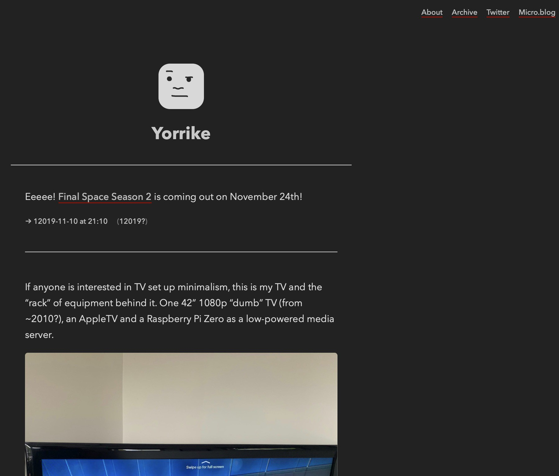 A screenshot of my website in dark mode - dark background with light text - links with a dark red underlline.