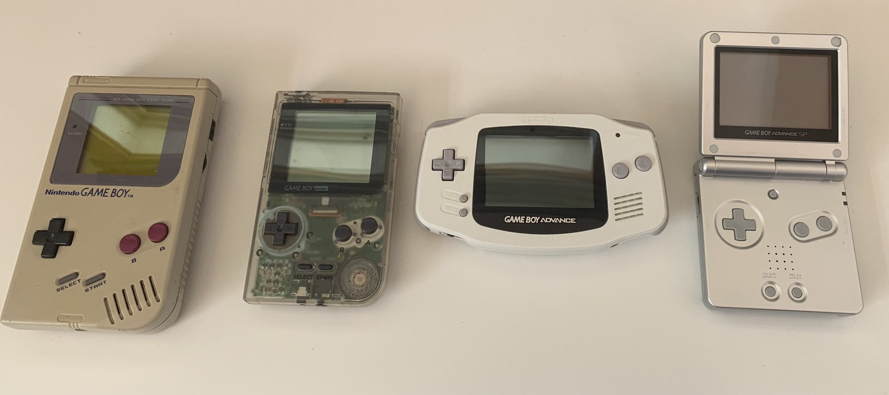 My remaining Game Boys - an Original, a transparent Pocket, an Original Game Boy Advance and a Game Boy Advance SP