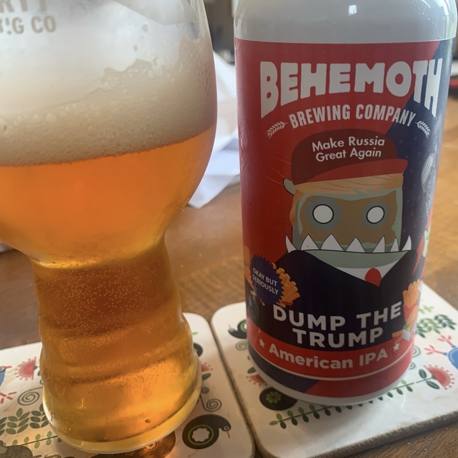 A glass and a can of Dump the Trump American IPA by Behemoth Brewing