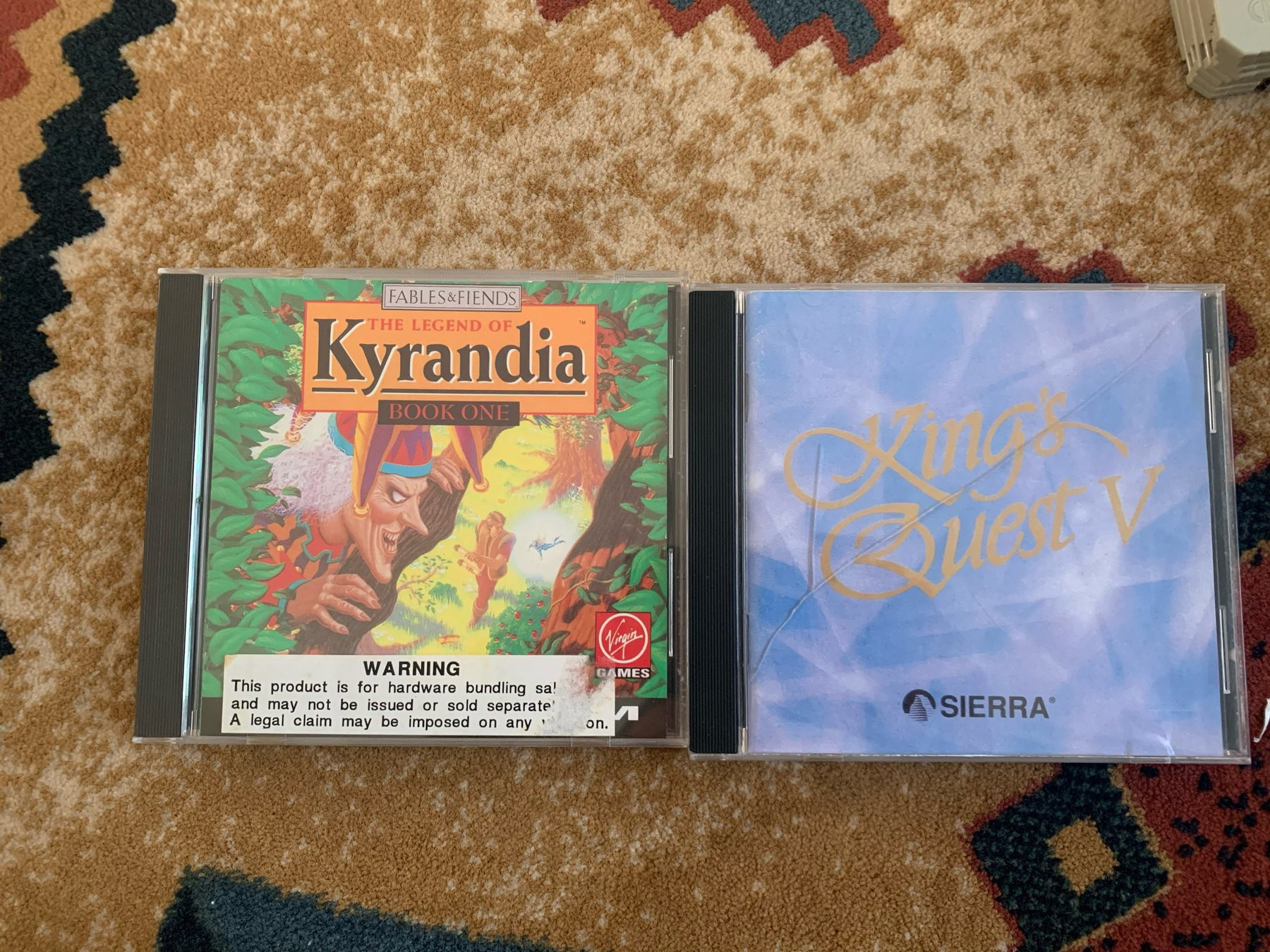 CDs for the games Legend of Kyrandia and Kings Quest V