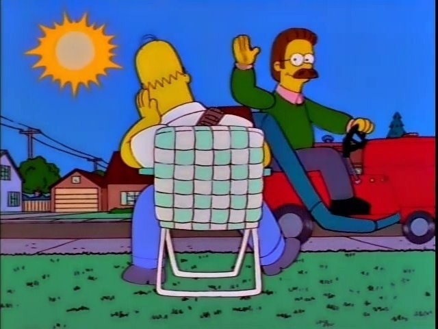 A screenshot from The Simpsons, with Homer waiting impatiently on his lawn.