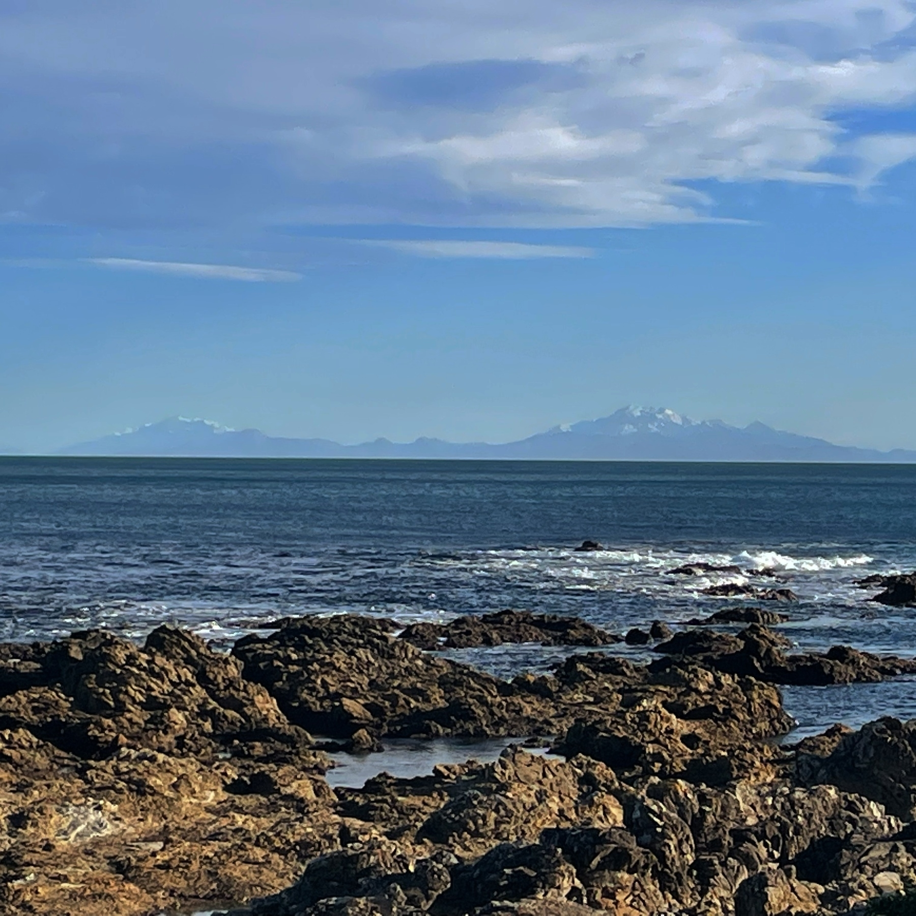 The mountains of the Kaikoura ranges, capped in snow, as seen from the southern Wellington coast